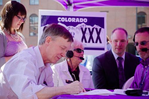 Signing CO Rockies' Charity License Plate Bill on opening day, 2003.